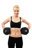 Athletic young lady working out with weights Royalty Free Stock Image
