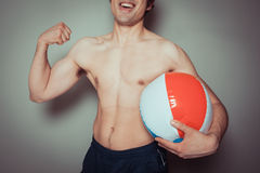 Athletic young man with beach ball Royalty Free Stock Photos