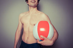 Athletic young man with beach ball Royalty Free Stock Images