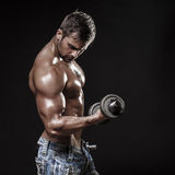 Athletic young man on black background Stock Photo