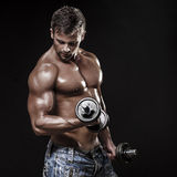 Athletic young man on black background Stock Photography
