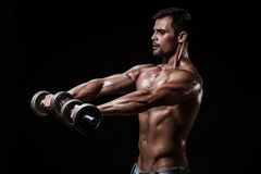 Athletic young man on black background Royalty Free Stock Photography