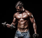 Athletic young man on black background Stock Photos