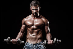 Athletic young man on black background Royalty Free Stock Photo