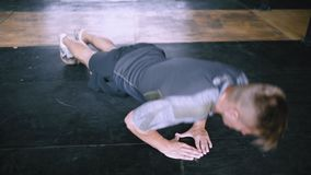 Explosive push ups diamond exercise. Athletic young man doing diamond push-ups in the gym for wellness, workout, muscular body and healthy life. Caucasian people stock video footage