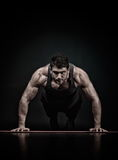 Athletic young man exercising Royalty Free Stock Photo