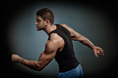 Athletic young man exercising Royalty Free Stock Image