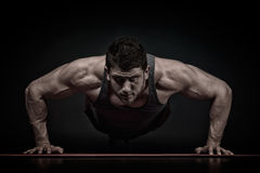 Athletic young man exercising Stock Image