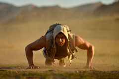 Athletic young man exercising outdoor Royalty Free Stock Photo