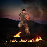 Athletic young man exercising outdoor Stock Images