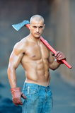 Athletic young man holding ax Stock Photography