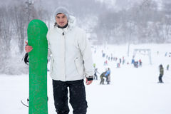 Athletic young man holding a snowboard Stock Photo