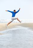 Athletic young man jumping Stock Image