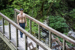 Athletic Young Man Leaning Against Pathway Rail Royalty Free Stock Image