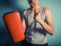 Athletic young man with martial arts pads royalty free stock photos