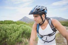 Athletic young man mountain biking Royalty Free Stock Photos