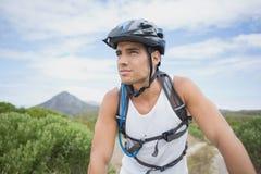 Athletic young man mountain biking Stock Photo
