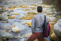 Athletic young man outdoor at river or water stream Stock Images