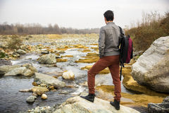 Athletic young man outdoor at river or water stream Royalty Free Stock Photo