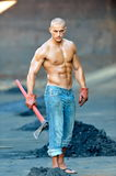 Athletic young man outdoor working Royalty Free Stock Image