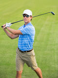 Athletic young man playing golf Royalty Free Stock Photo