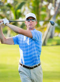 Athletic young man playing golf Stock Photography