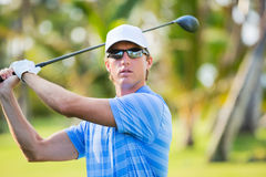 Athletic young man playing golf Royalty Free Stock Image