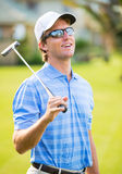 Athletic young man playing golf Royalty Free Stock Photography