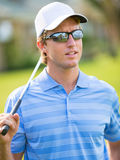 Athletic young man playing golf Royalty Free Stock Images