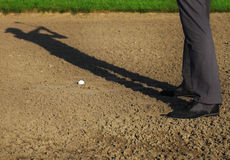 Athletic young man playing golf, swinging club Stock Photo