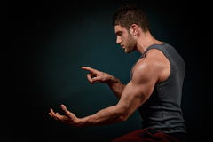 Athletic young man portrait in studio Royalty Free Stock Photos