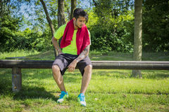 Athletic young man resting in city park Stock Photography