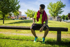 Athletic young man resting in city park Royalty Free Stock Image