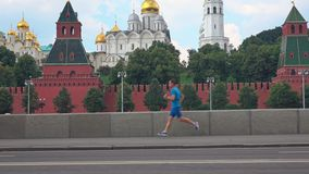 Athletic young man running against Moscow Kremlin. Athletic young man runs against Moscow Kremlin, Russia Royalty Free Stock Photography