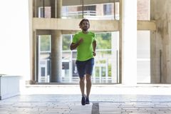 Athletic young man running and working out in the city. Athletic young man running and working out in urban enviroment Royalty Free Stock Photos