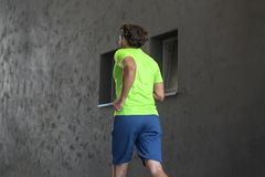 Athletic young man running and working out in the city. Athletic young man running and working out in urban enviroment Stock Image