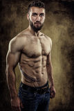 Athletic young man with six pack Royalty Free Stock Photography