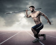 Athletic young man with spear. In the Stadium Stock Photography