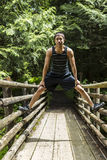 Athletic Young Man on Wooden Bridge Stock Photo