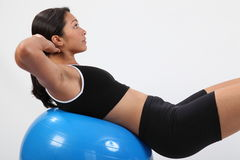 Athletic young sports woman using exercise ball Royalty Free Stock Photography