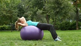 Athletic young sports woman using exercise ball stock video footage