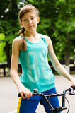 Athletic young teenage girl with a bicycle Stock Photo