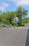 Athletic young teenager roller skating Stock Images