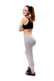 Athletic young woman with arms folded standing with the back at Stock Images