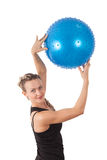 Athletic young woman with blue ball Stock Photography