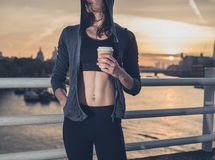 Athletic young woman with cup in London at sunrise Royalty Free Stock Photography