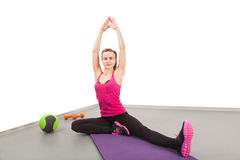 Athletic young woman doing exercises Stock Image