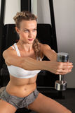 Athletic young woman with dumbbell Royalty Free Stock Photos