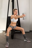 Athletic young woman with dumbbell Royalty Free Stock Images