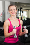 Athletic young woman with dumbbells Royalty Free Stock Photos